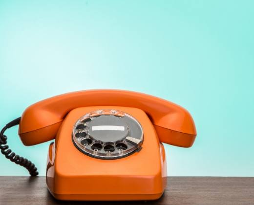 Image of old fashion telephone with rotary dial