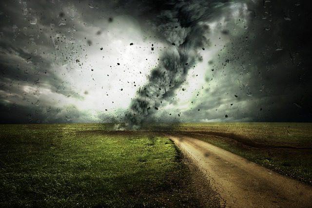 photo of tornado on the ground near a road which illustrates the NOAA Public Alert Radio program
