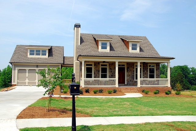 This is a photo of a newly constructed home with a detached garage and a front porch. It is used to illustrate residential services page of the website.