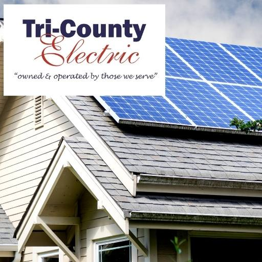 photo of house with solar panels on the roof with the Tri-County Electric logo