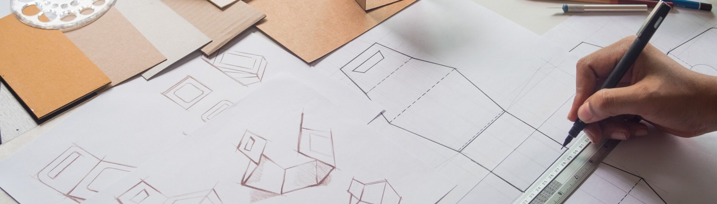 designer-sketching-drawing-design-brown-craft-cardboard-paper-product-picture-id1160699339 (1)