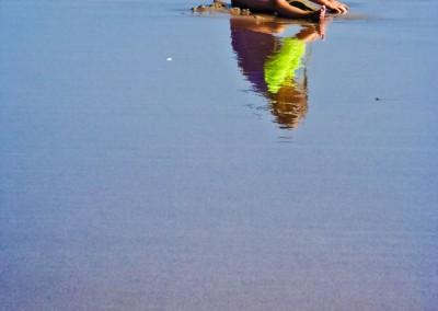 31little girl reflected on sand