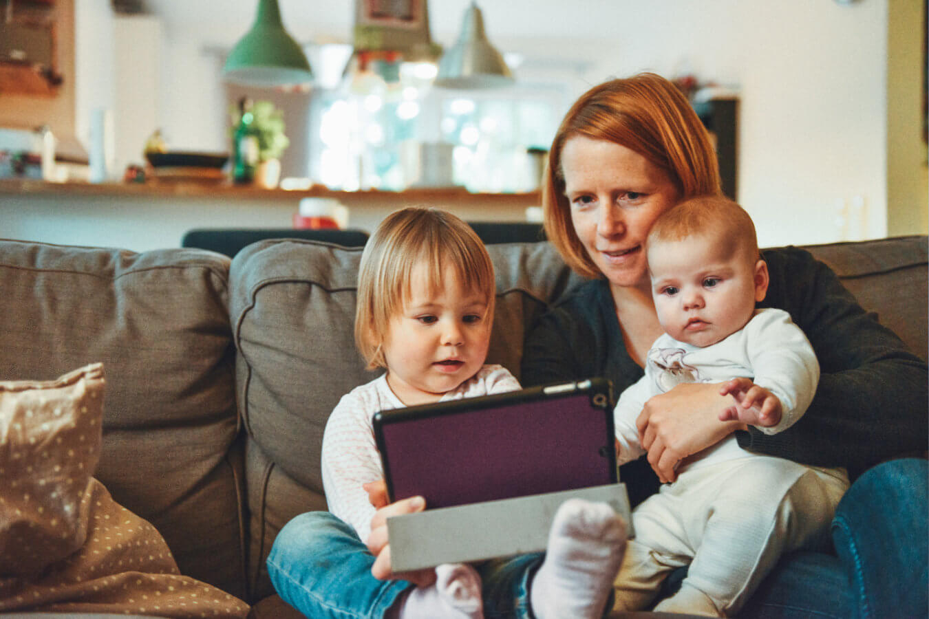 Mom with Two Kids Accessing a Tablet