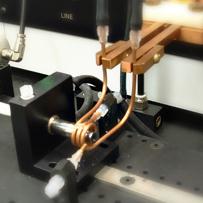 flexible catheter tipping machine coils