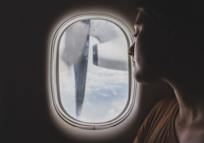 An airplane's window seat can make it easier to fall asleep on long flights.