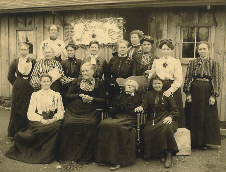 First Thursday Club 1904. First Row L to R (Sitting): Mrs. Braker, Mrs. S. S. Long, Grandma Cushing, Fannie Croyle Second Row: Mrs. E. E. Sanford, Mrs. Pierson, Mary E. Lovejoy (Later Mrs. LeGrave), Mrs. Gearhart, Mrs. Cook, Clara Meyer, Minnie Staiff Third Row: Minnie Jones, Bertine Croyle