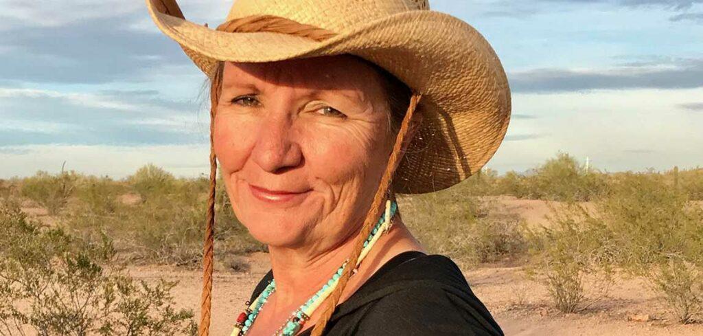 Debra Laughlin in cowgirl hat