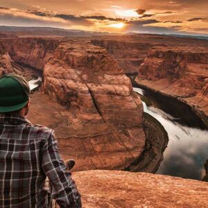 man looking at view of horseshoe bend Arizona