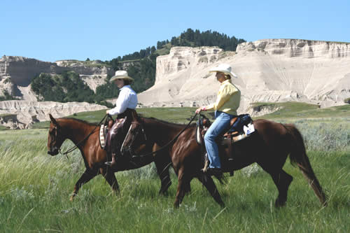 Riding horses at Our Heritage Guest Ranch