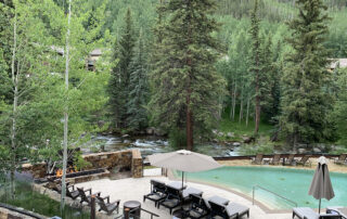 Grand Hyatt Vail in Summer - View from Gessner Bar over Pool and Gore Creek