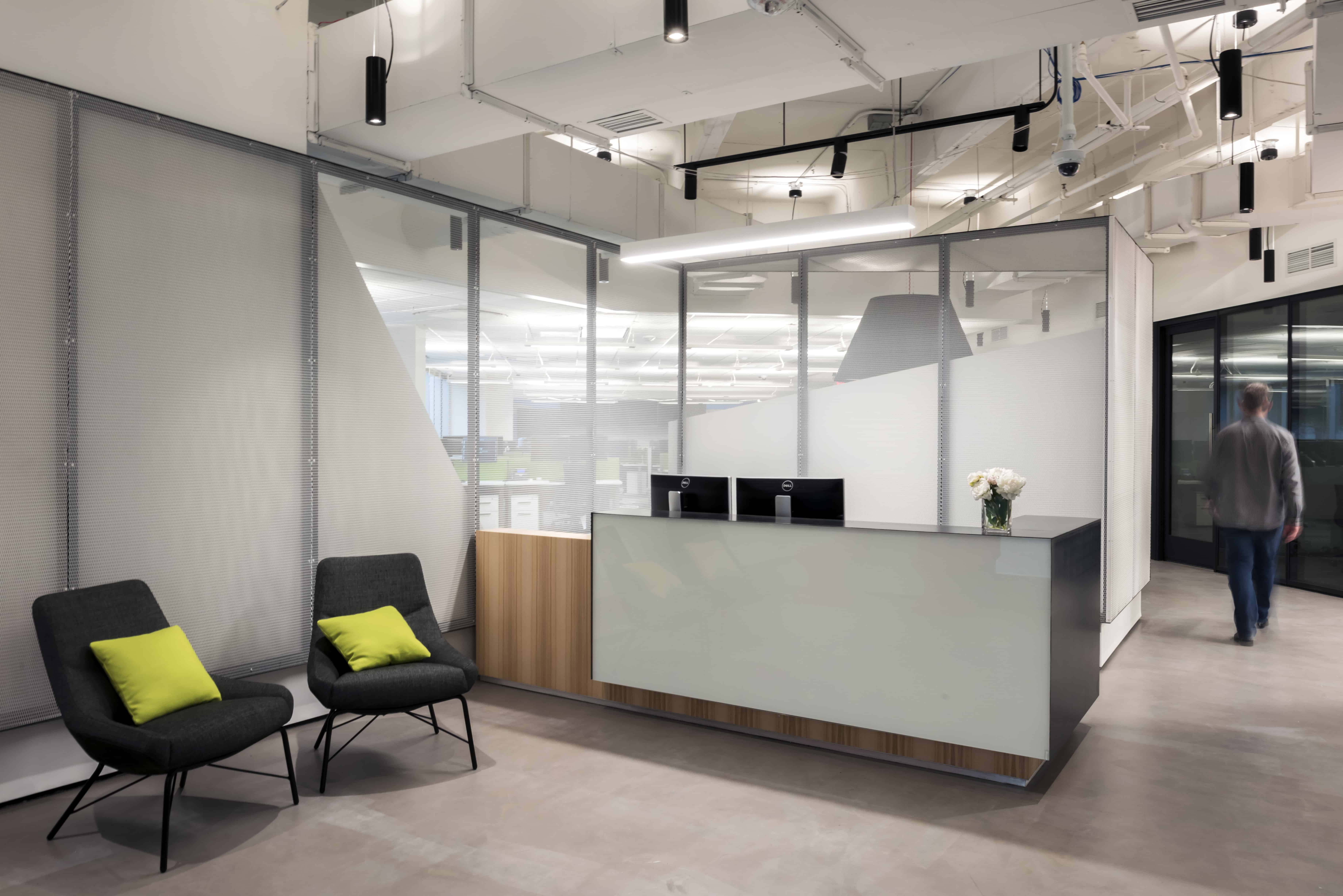 custom steel and glass reception desk and metal screen