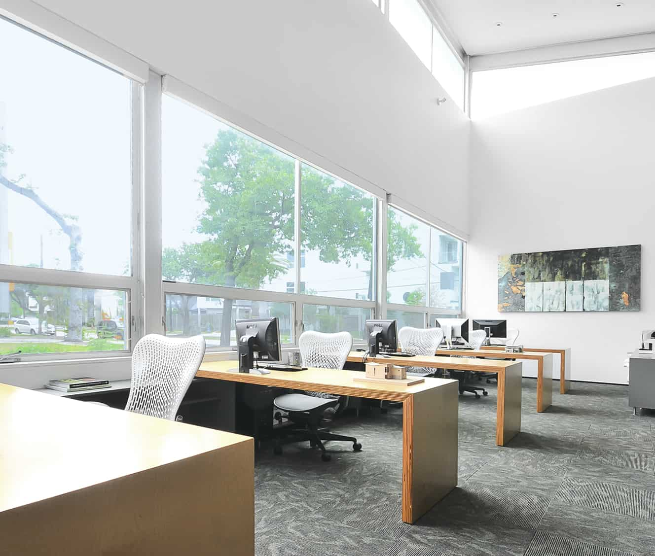 open work area with high ceiling and windows