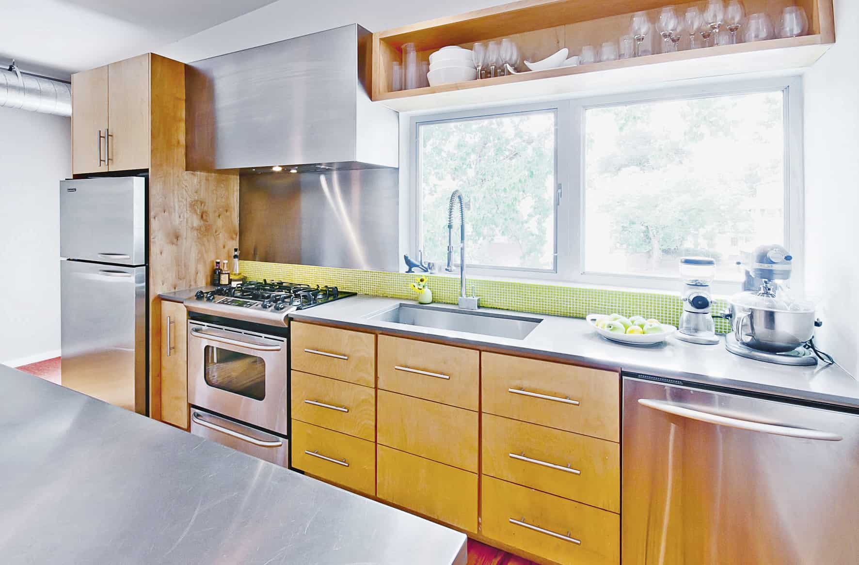 live work studio kitchen with stainless counter tops