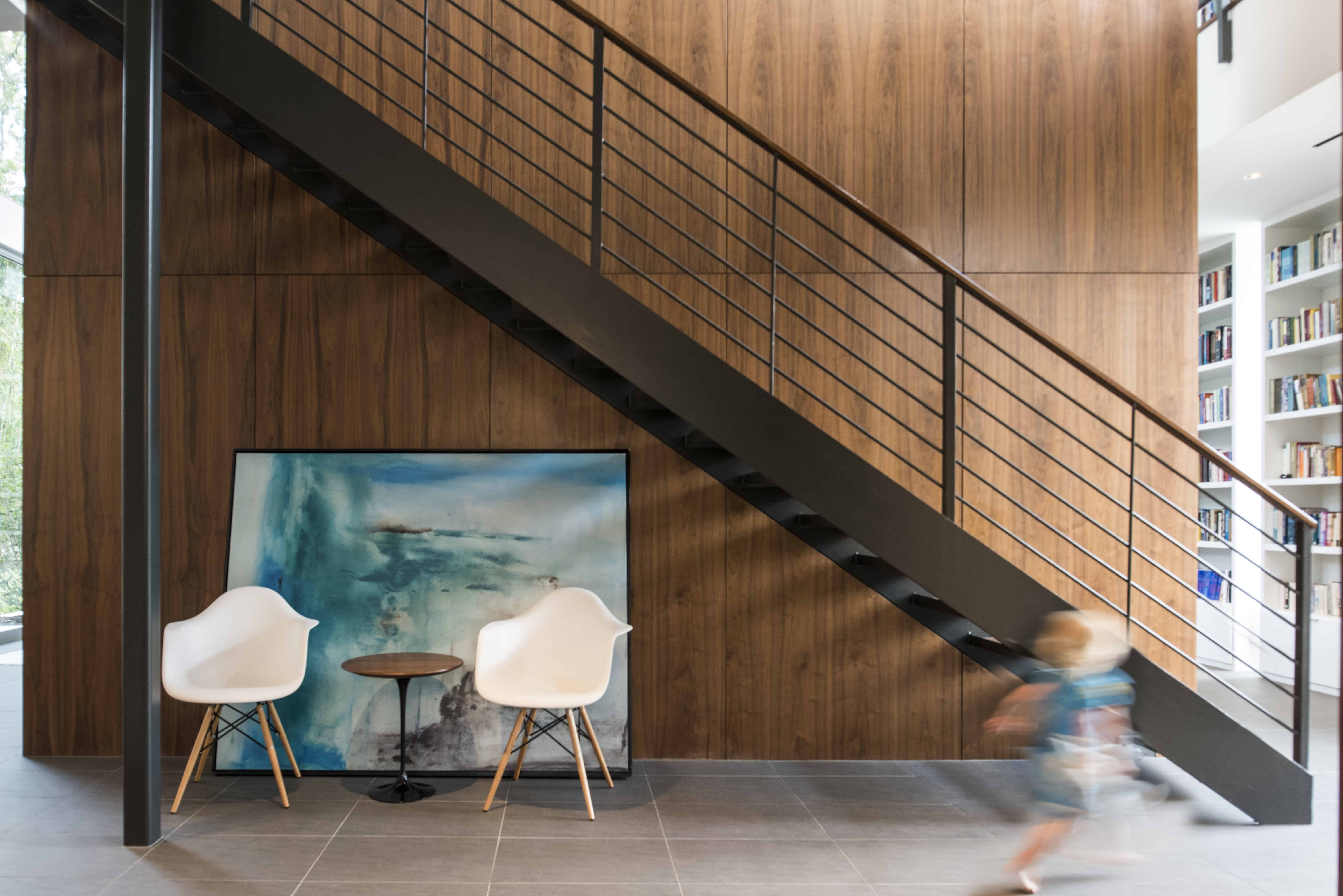 Hunters Creek Memorial Modern Custom Home walnut panel and stair