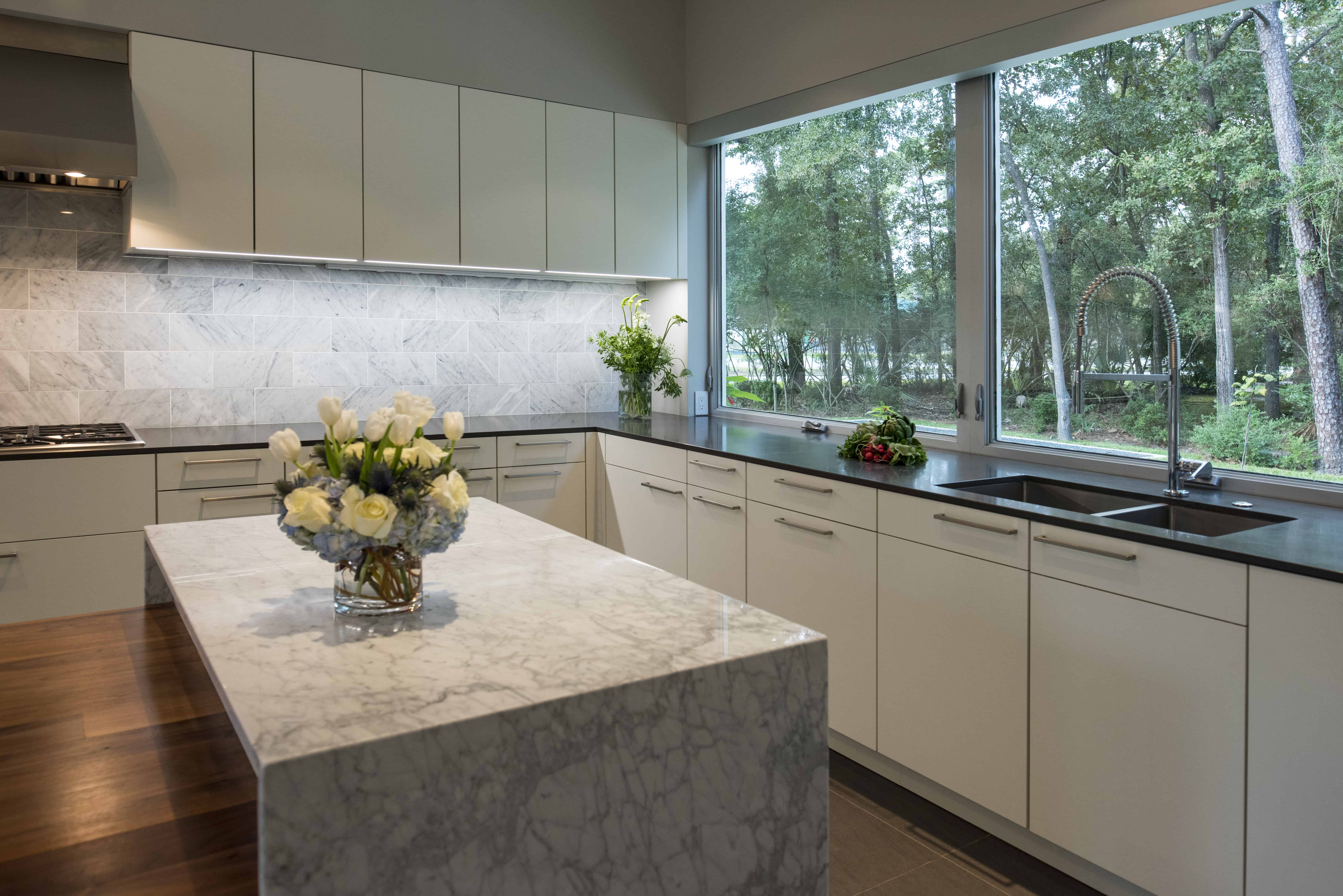 Hunters Creek Memorial Modern Custom Home kitchen grey and white with walnut island and marble