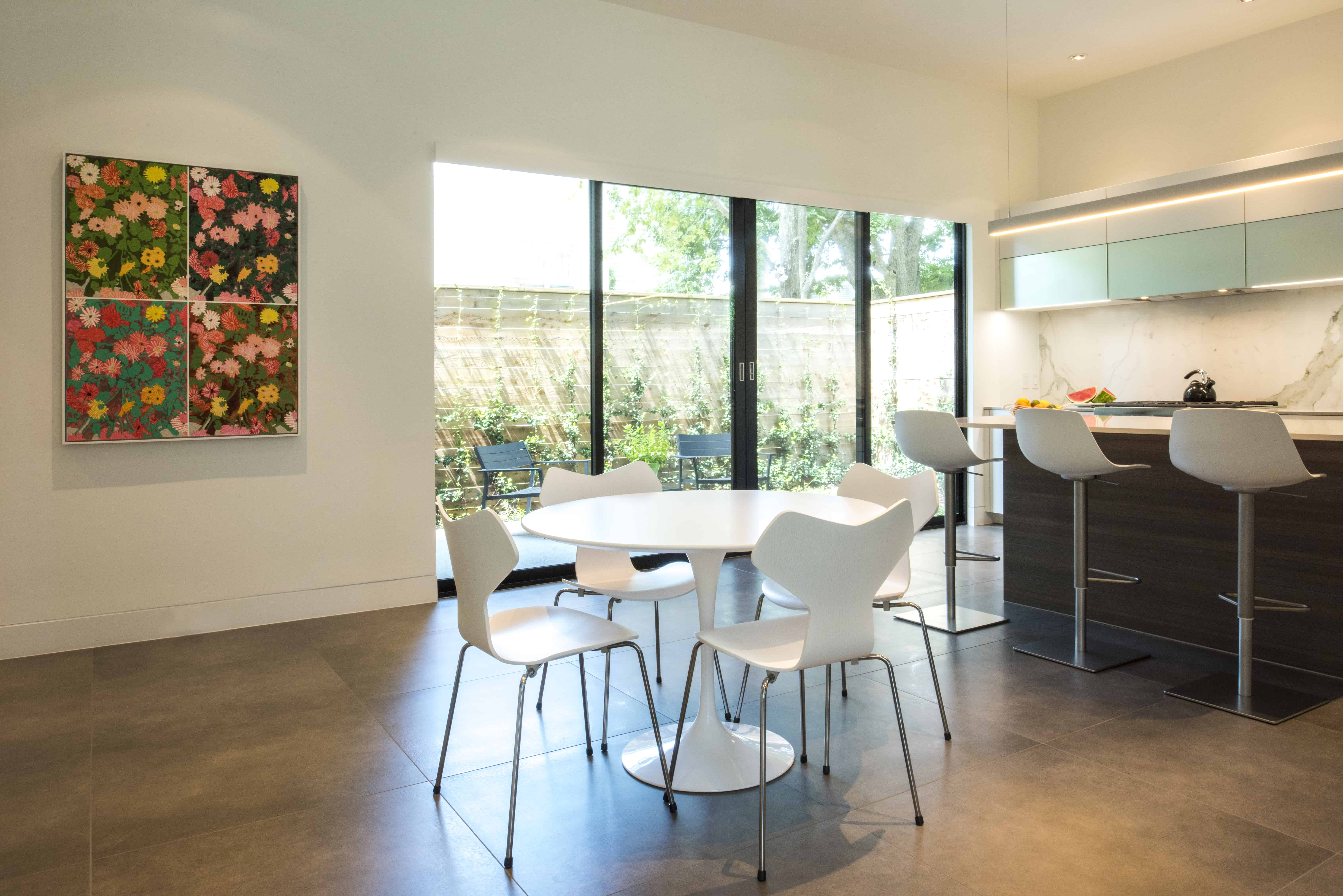 Empty Nester Modern Home with Lock and Leave and Aging in Place Features Breakfast area.