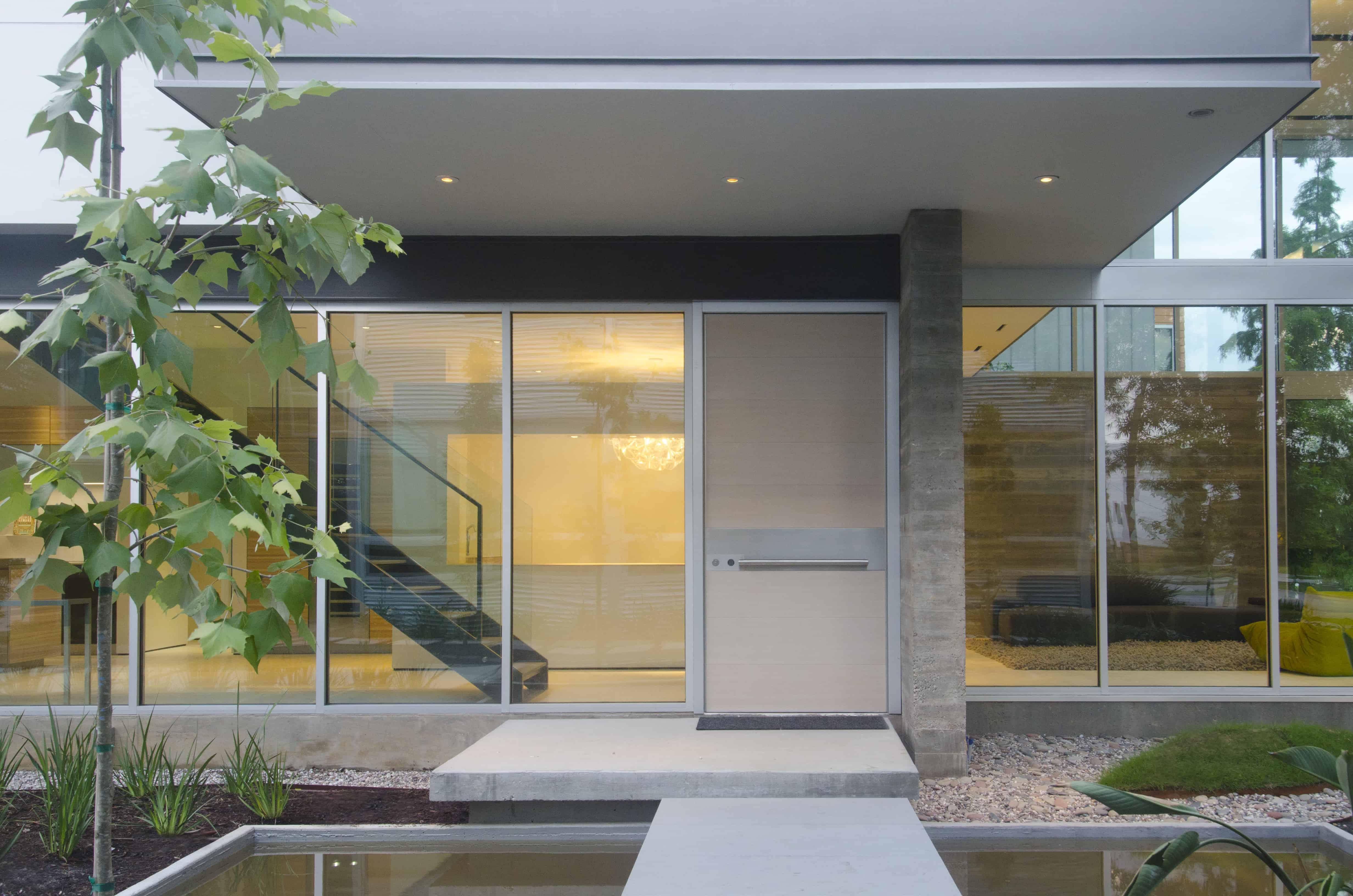 sleek modern home houston entry with koi poind