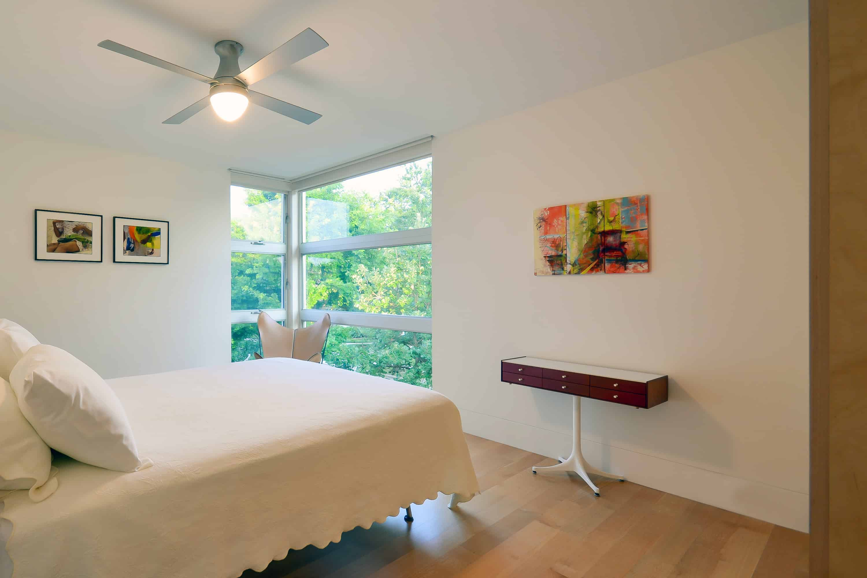 Guest room with modern corner window