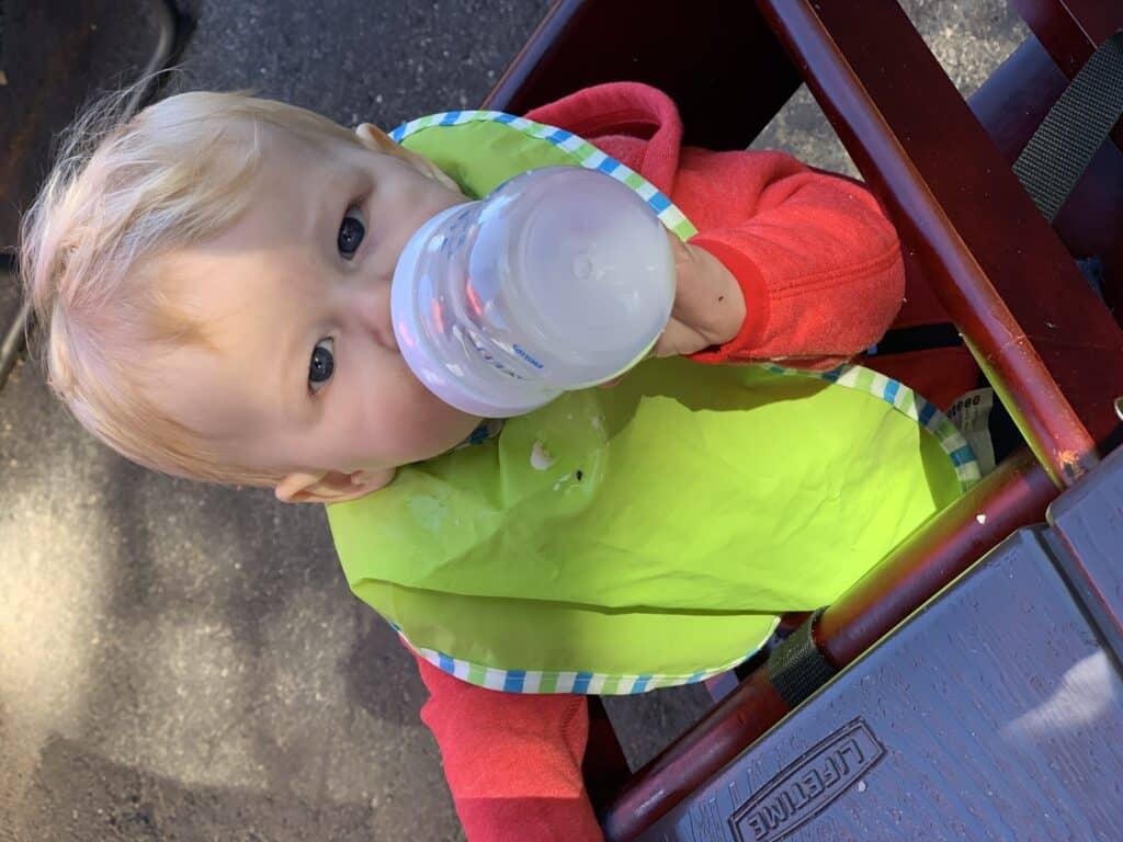 Baby drinking a bottle of breastmilk