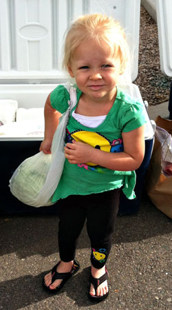 leila carrying a cabbage