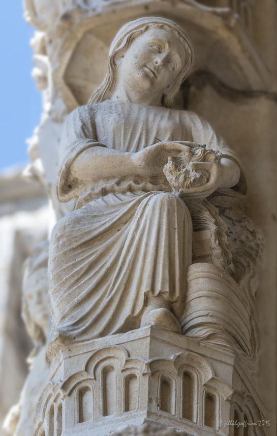 Sculpture of active woman, North Porch