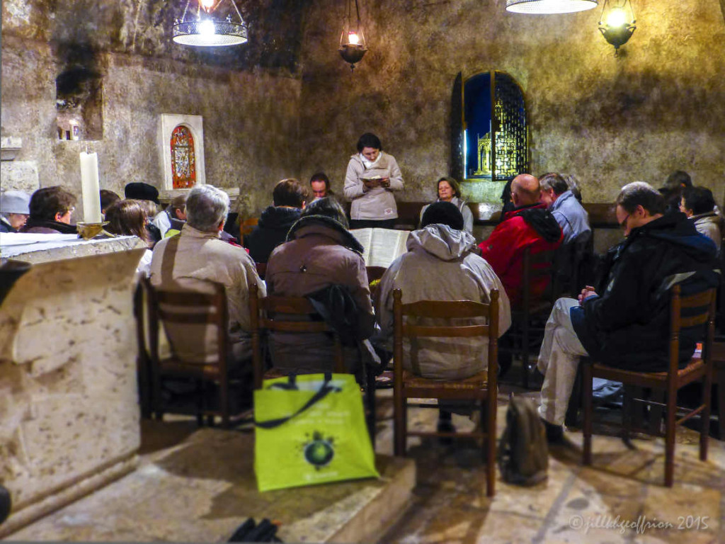Evening Prayer Group in the crypt of Chartres Cathedral by photographer Jill K H Geoffrion