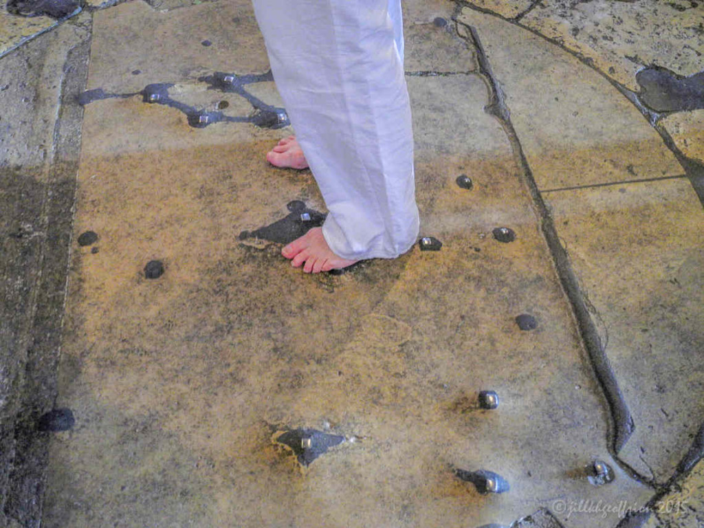 Woman's bare feet in the center of the labyrinth in the Chartres Cathedral by photographer Jill K H Geoffrion