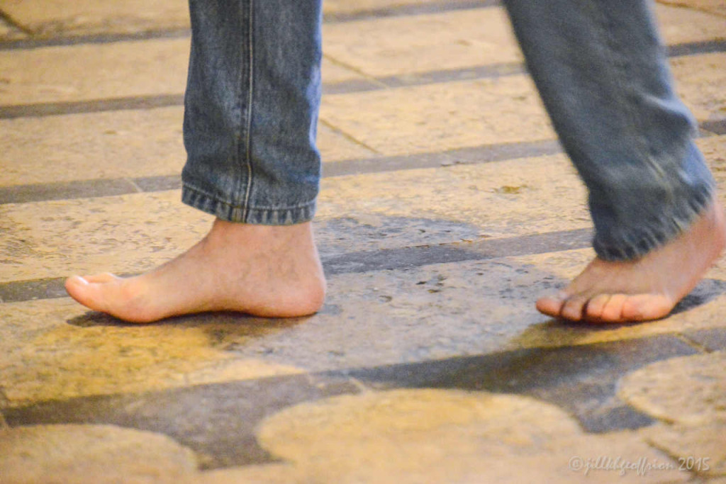 Man walking the labyrinth in bare feet at the Chartres Cathedral by photographer Jill K H Geoffrion