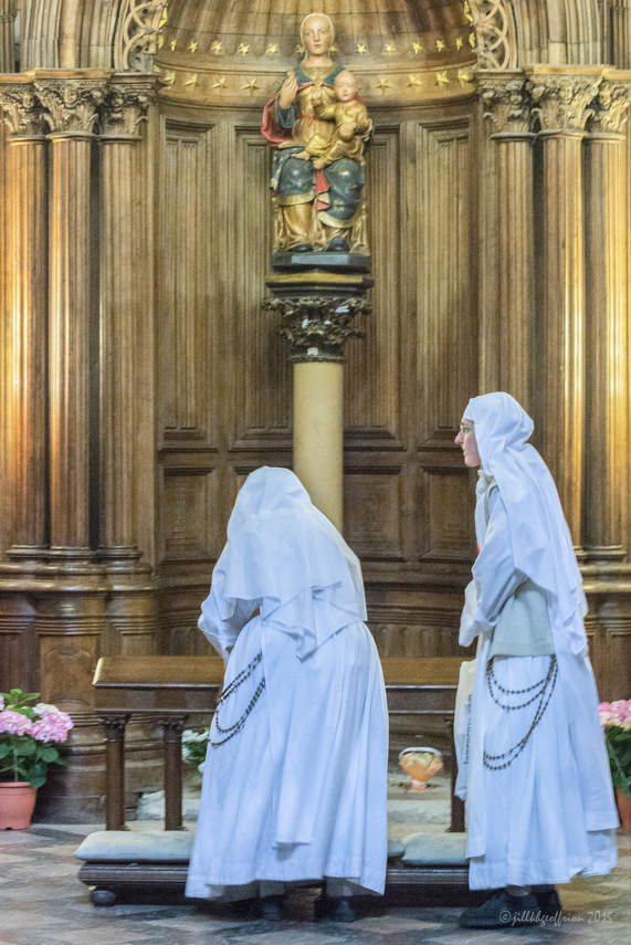 Nuns in the Chapel of Notre Dame du Pilier at Chartres Cathedral by photographer Jill K H Geoffrion