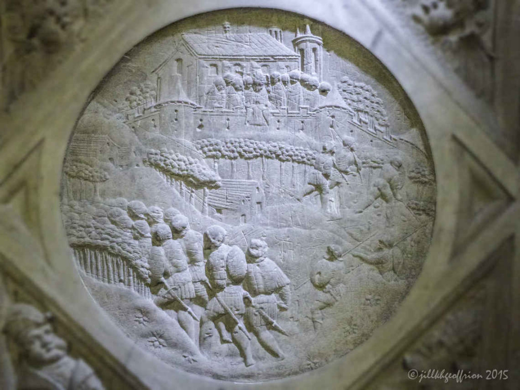 Mary's Veil being exposed over the ramparts by Bishop Guillaume in 911. Medallion of the outer south ambulatory of the choir at Chartres Cathedral by photographer Jill K H Geoffrion