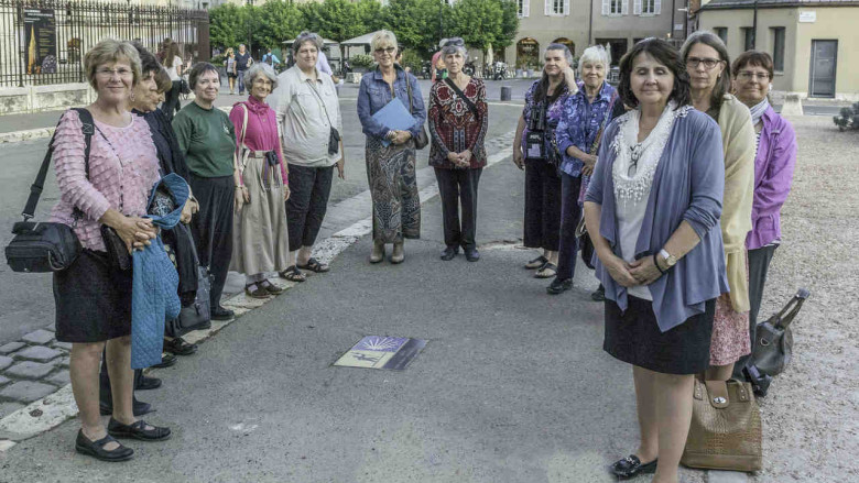 Women's pilgrimage group outside the west wall at Chartres Cathedral by photographer Jill K H Geoffrion