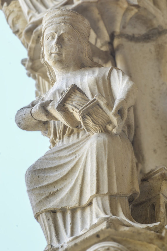 Active Woman Carding Flax, North Porch at Chartres Cathedral by photographer Jill K H Geoffrion