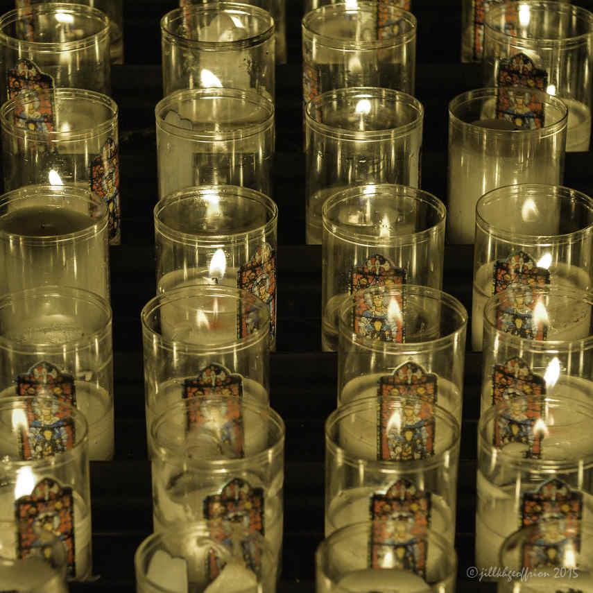 Candles burning (with the image of Notre Dame de la Belle Verrière)