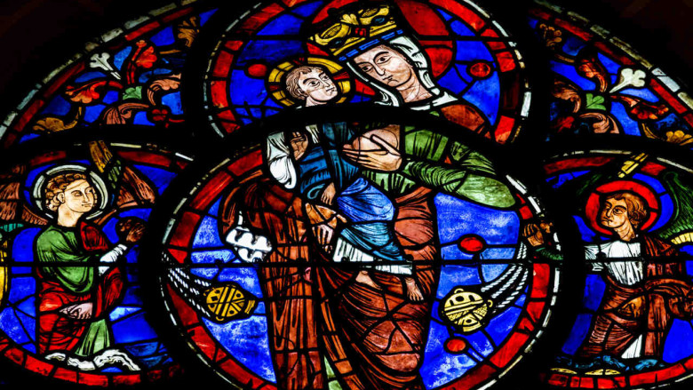 Stained glass image of Mary breastfeeding at Chartres Cathedral by photographer Jill K H Geoffrion