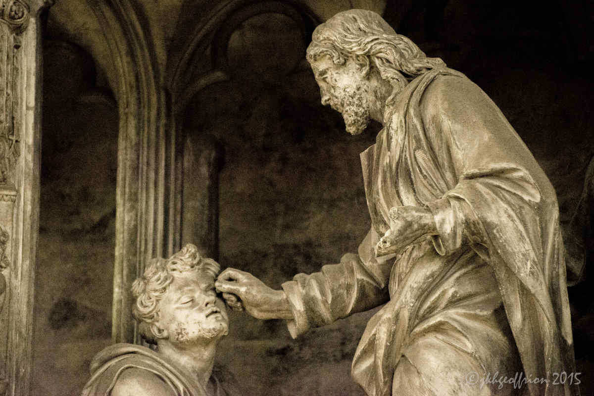 Jesus opening the eyes of the blind man, outer choir sculpture at Chartres Cathedral by photographer Jill K H Geoffrion