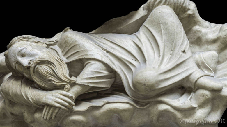 Jesse dreaming under the statue of Isaiah at Chartres Cathedral by photographer Jill K H Geoffrion