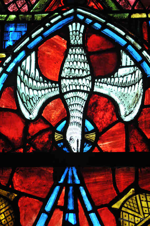 Representation of the Holy Spirit in the Window of the Beautiful Lady at Chartres Cathedral by photographer Jill K H Geoffrion
