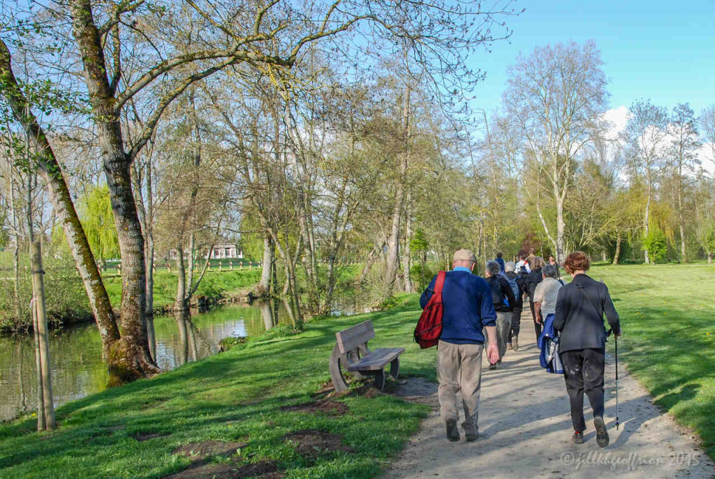 Pilgrims walking along the Eure River towards the cathedral in Chartres by Jill Geoffrion, photographer