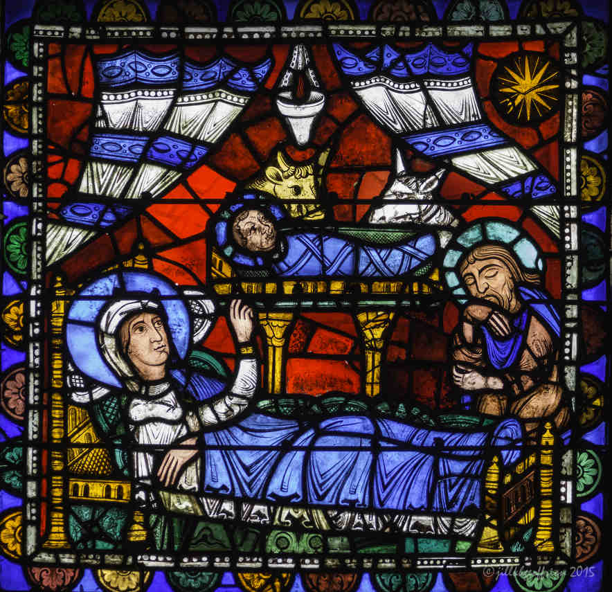 Nativity, 12-century stained glass window at Chartres Cathedral  by Jill K H Geoffrion