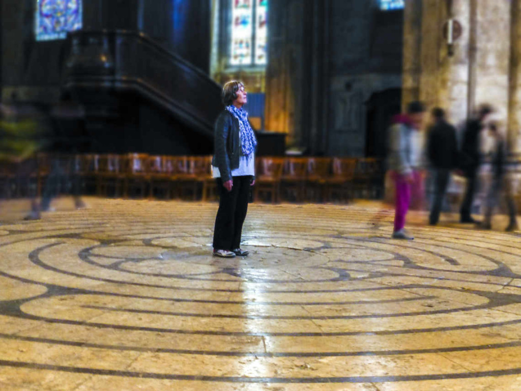Praying in the center of the Chartres labyrinth by photographer Jill K H Geoffrion