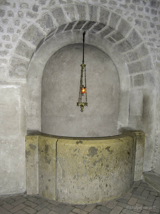 The well of the Holy Martyrs in the crypt at Chartres Cathedral by photographer Jill K H Geoffrion