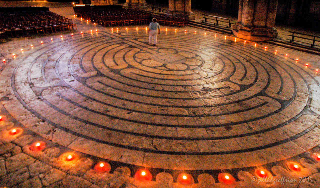 Labyrinth walker at night with candles