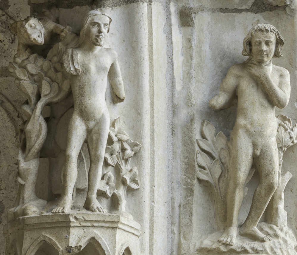 Adam choking, Eve listening to the serpent in the Garden of Eden at Chartres Cathedral by photographer Jill K H Geoffrion