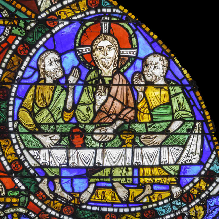 Jesus at table in Emmaus in the Passion and Resurrection Window at Chartres Cathedral by photographer Jill K H Geoffrion