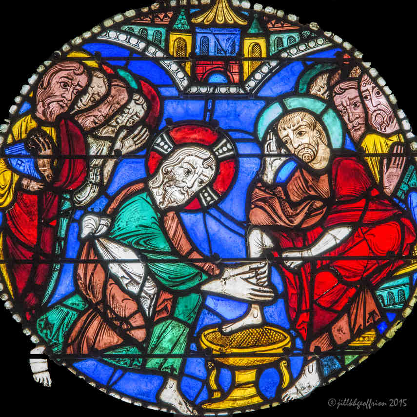 Jesus washing Peter's foot in the Passion and Resurrection Window at Chartres Cathedral by photographer Jill K H Geoffrion