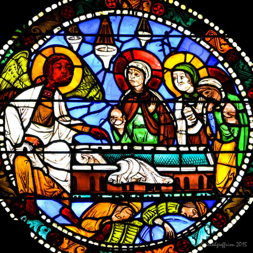 The angel and Marys at Jesus's tomb in the Passion and Resurrection Window at Chartres Cathedral by photographer Jill K H Geoffrion