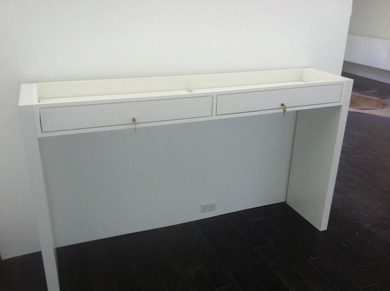 Standalone pedestal display with lockable drawers