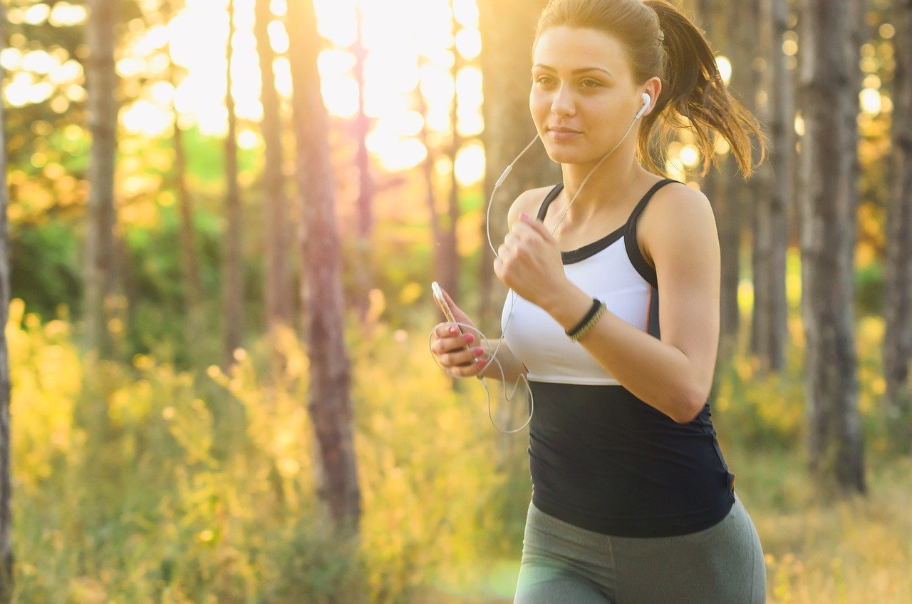 A woman running . Her exercising has a profound effect on her mental health.