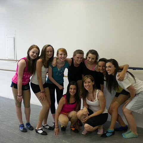 A group of teenage girls at a dance studio with their teacher Jeanette Mangulis