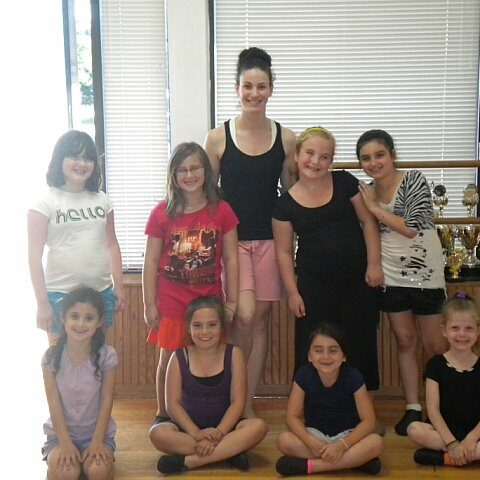 A group of young girls at a dance studio with their dance teacher Lauren O' Brien